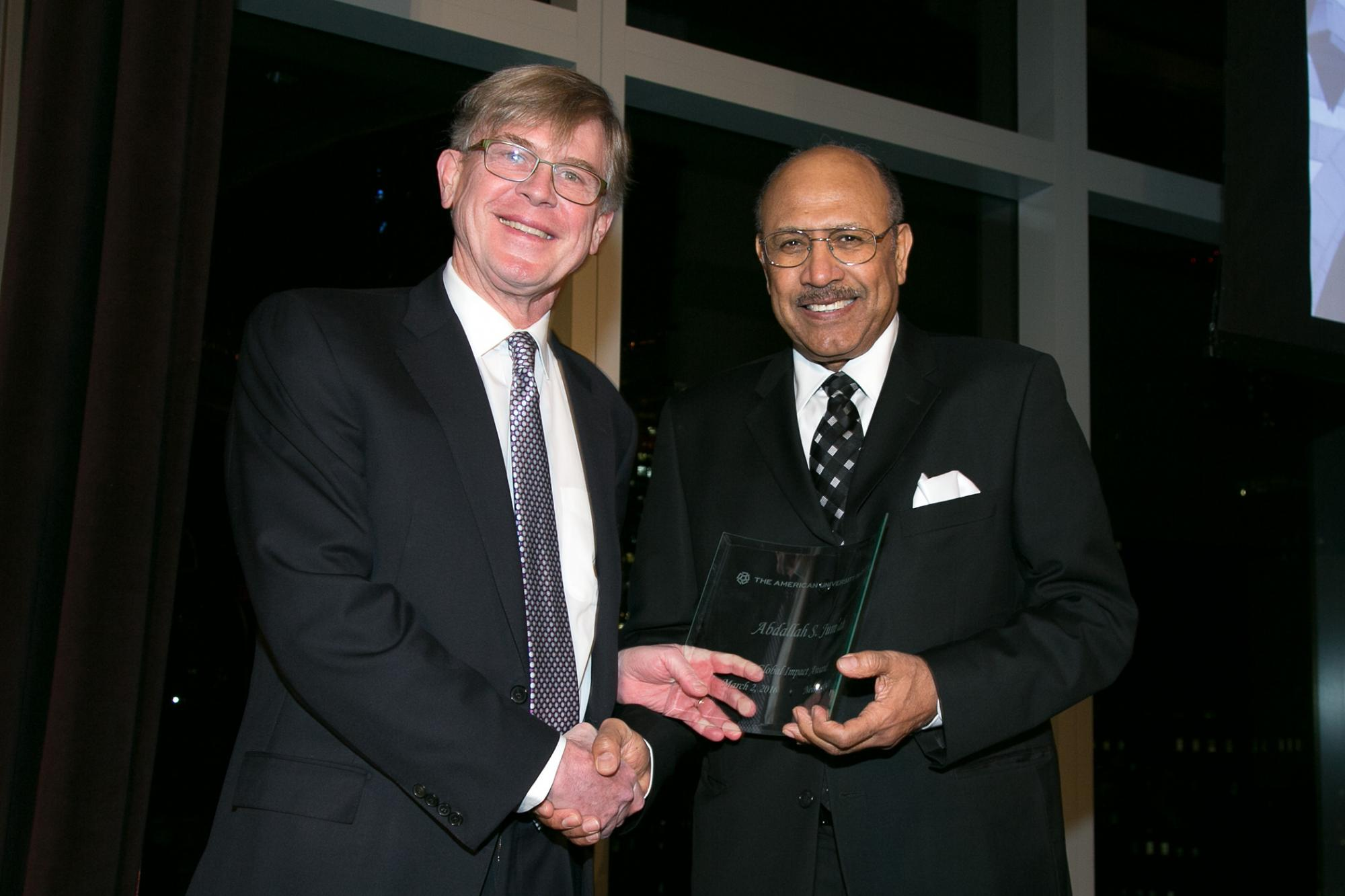 Board of Trustees Chairman Richard Bartlett presents Abdallah S. Jum'ah '65 with the Global Impact Award
