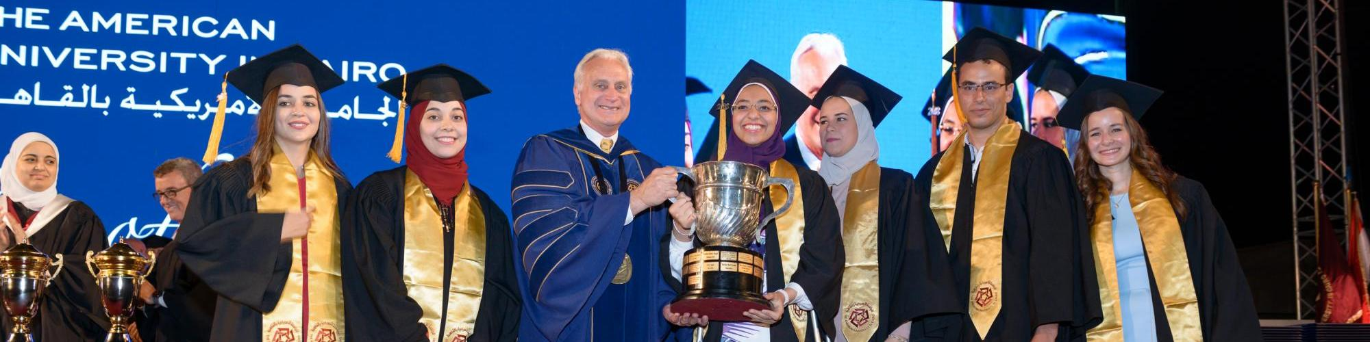 Salma Mostafa Farrag, Nadine Ahmed Wahdan, Yasmine Ahmed Galal, Rana Samir Ead, Badr Khaled Alkhamissi and Salma Shukry Emara receive the President's Cup for the highest grade point average of their graduating class