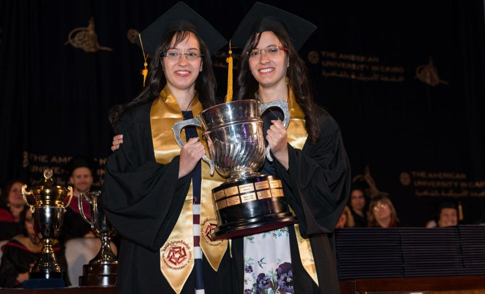 Helen Saher Rizkalla and Haidy Saher Rizkalla receive the President's Cup for the highest grade point average of their graduating class