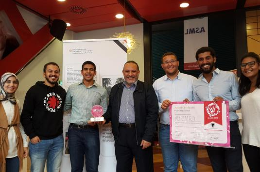 Azzazy (center) with the winning team of AUC students
