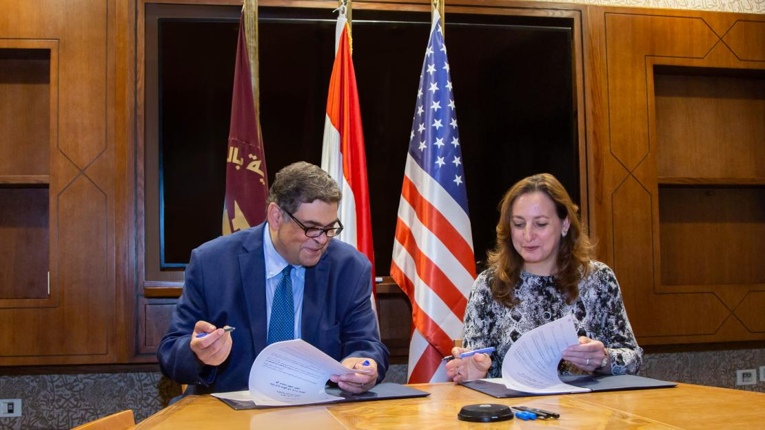 AUC Counselor Ashraf Hatem and NMI Executive Director Sherifa Fouad Sherif sign the memorandum of understanding