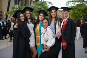 AUC graduates smile as they finish their experience at the University's 2018 Commencement Ceremony.