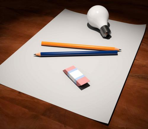 pen and paper with light bulb