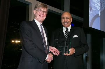 Board of Trustees Chairman Richard Bartlett presents Global Impact Award to Abdallah S. Jum'ah '65