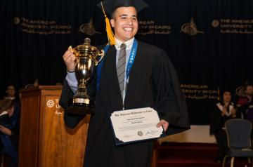 Ahmed Khaled Etman receives the Student Government Cup for making an impact on the AUC community through his position in the student government