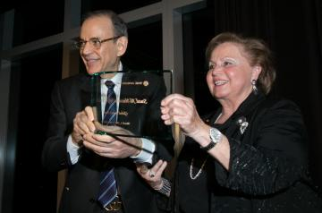 Board Chair Atef Eltoukhy '74 presents Suad Juffali with the Global Impact Award